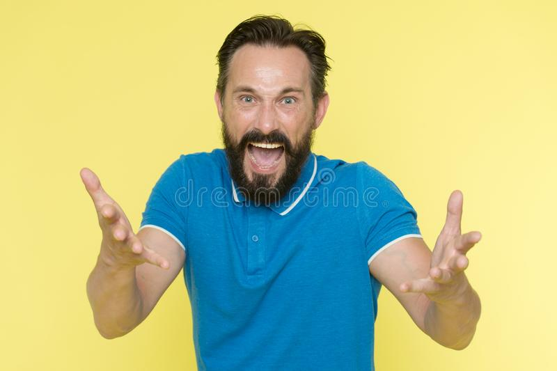 What are you doing. Stop annoying him. Overwhelmed with emotions. Handsome shouting mature man screaming standing royalty free stock photo