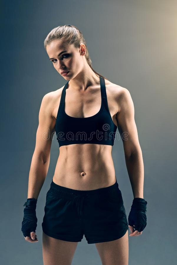 Strong female boxer looking into camera confidently royalty free stock photos