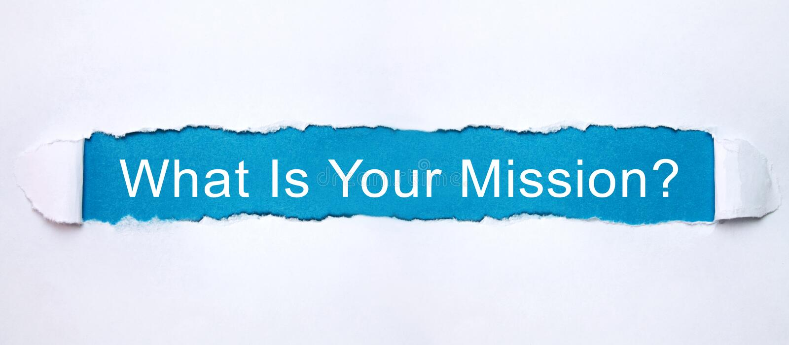 What Is Your Mission? text in torn paper royalty free stock image