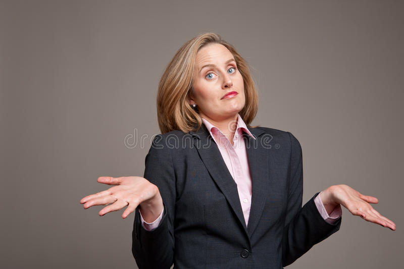 Whatever. Businesswoman shrugging her shoulders as if to say whatever stock photos