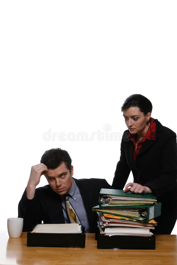 Whatever. An isolated shot, on white, of a businessman and businesswoman at a desk stock images