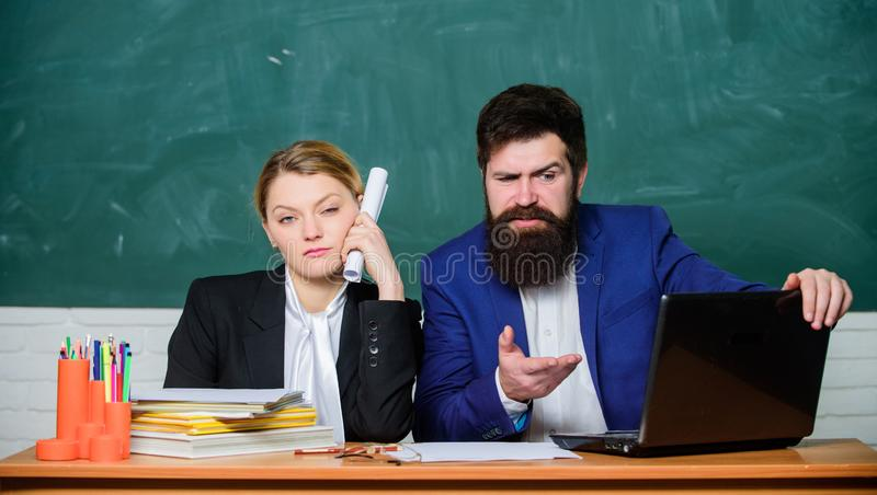 Whatever concept. School educator indifferent about and schoolmaster different opinion. School staff. School collective. And colleagues relations. Teacher and royalty free stock image