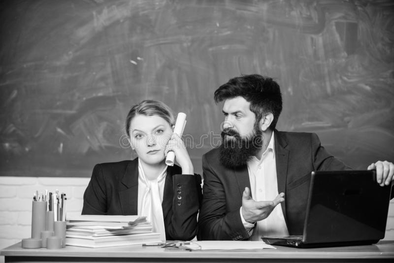 Whatever concept. School staff. School collective and colleagues relations. Teacher and supervisor working in school. Classroom. School educator indifferent royalty free stock image