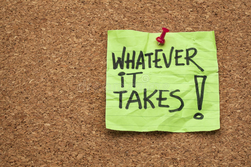 Whatever it takes. Motivational slogan - handwriting on a sticky note posted on a cork board stock image