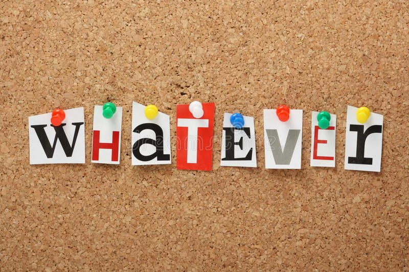 Whatever. The word Whatever in cut out magazine letters pinned to a cork notice board stock photography