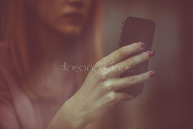 Whatever you need is just a call away. Caucasian businesswoman with phone in hand. Close up royalty free stock photo