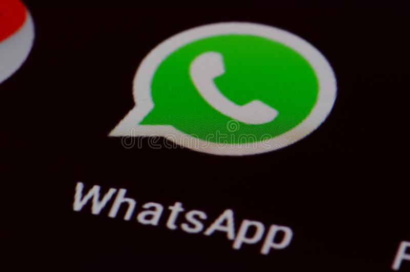 Whatsapp. App on the screen of a smartphone, reeware and cross-platform messaging and Voice over IP VoIP service owned by Facebook stock images