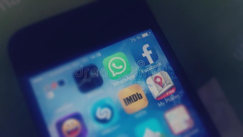 WhatsApp and Facebook. The icons of WhatsApp and Facebook applications on an smartphone screen royalty free stock photos