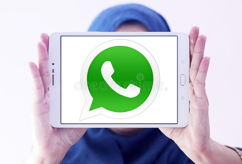 Whatsapp logo. Logo of Whatsapp application on samsung tablet holded by muslim woman royalty free stock photos