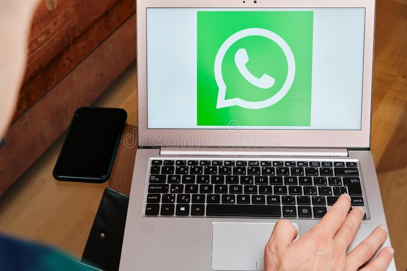 Whatsapp used for business meeting on laptop.