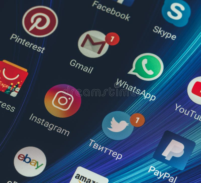 WhatsApp, YouTube, instagram, Facebook, Skype and other app icons on the smartphone screen Xiaomi. Adygea, Russia - January 3, 2018: WhatsApp, YouTube, instagram stock photography