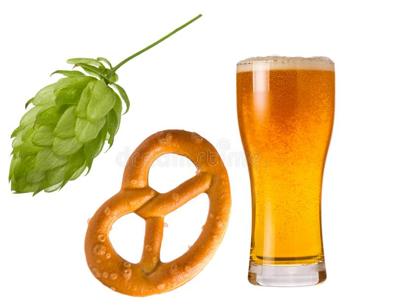Wheat beer in glass, hop cone and pretzel isolated on white background as detail for Oktoberfest design stock photo