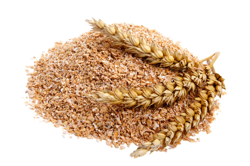 Wheat bran. With ears on white background. It is common ingredient of healthy meal stock photography