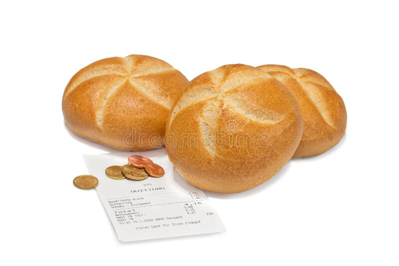Wheat buns with bill and coins on white background stock photography