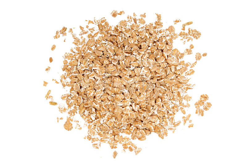 Wheat cereal. On white background. It is common ingredient of healthy meal royalty free stock photo