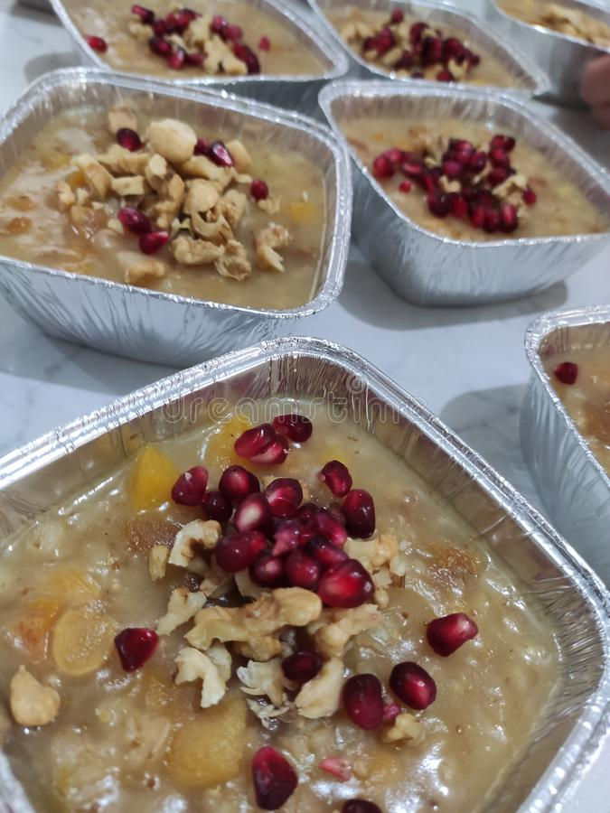 Wheat pudding with dried nuts and fruits Asure. Wheat dessert with dried nuts and fruits. Asure in Turkish; also known as Noah`s ark pudding royalty free stock image