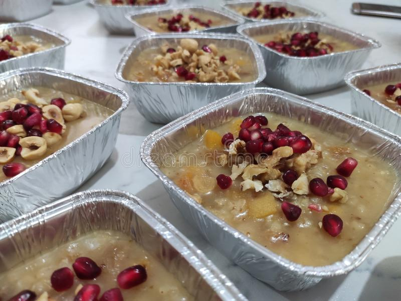 Wheat pudding with dried nuts and fruits Asure. Wheat dessert with dried nuts and fruits. Asure in Turkish; also known as Noah`s ark pudding royalty free stock photo