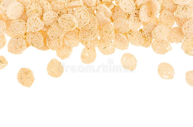 Wheat dry brown bread cut on small pieces as decorative border with copy space, isolated. Fast food background, top view. Wheat dry brown bread cut on small stock photography