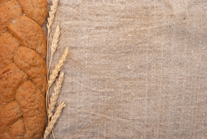 Wheat ears and bread stock images