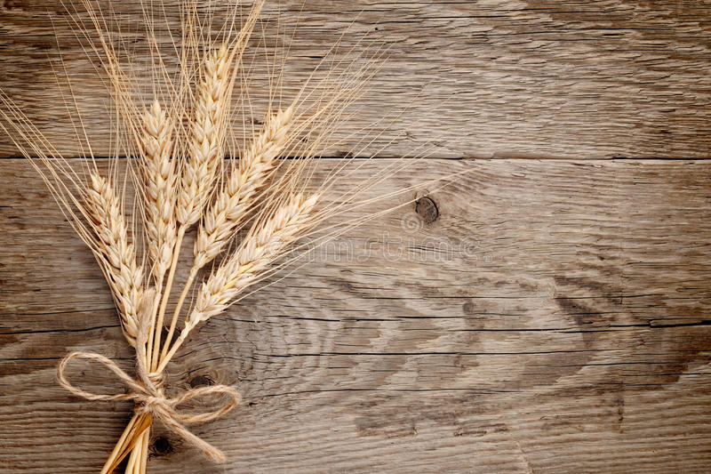 Download Wheat ears on wood stock photo. Image of rural, food - 25424050