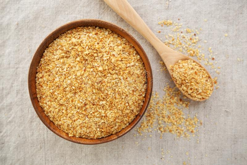 Wheat germ in bowl. Background from top view stock photo