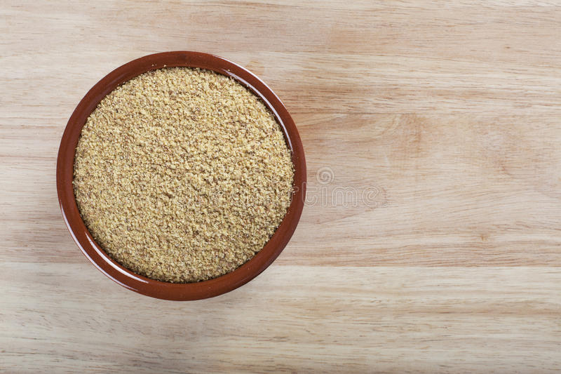 Wheat Germ. Bowl of wheat germ on wooden surface stock photo