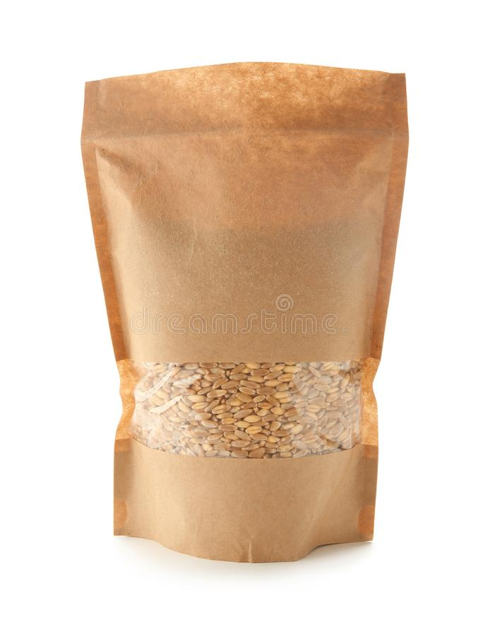 Wheat grass seeds in paper package on background stock photography