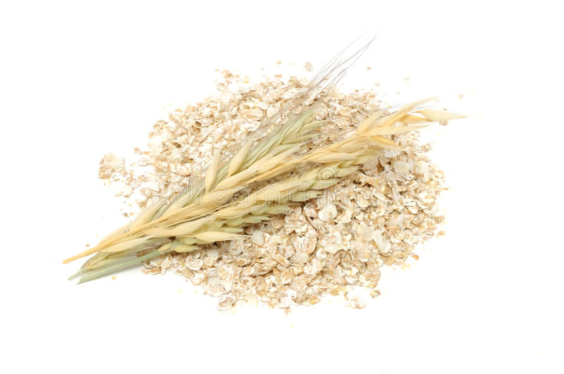 Wheat, Oat And Rye Flakes with Ears royalty free stock image