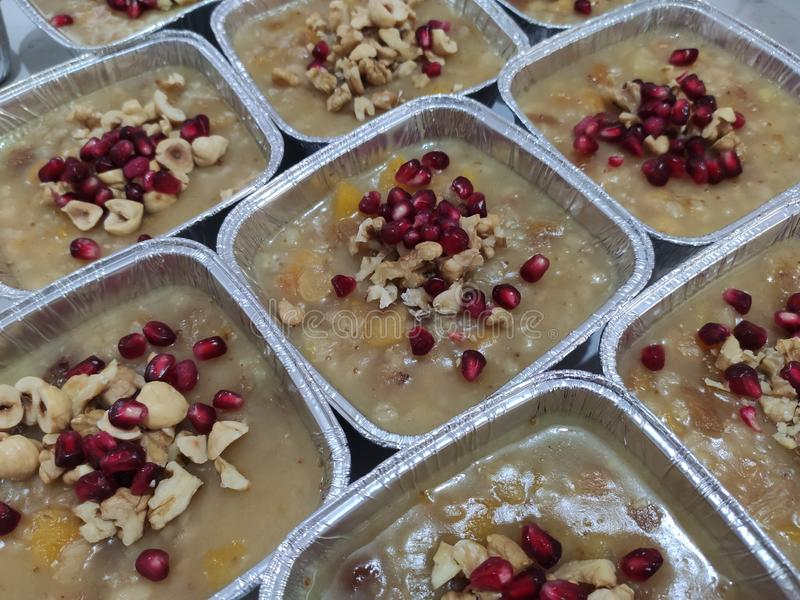 Wheat pudding with dried nuts and fruits Asure. Wheat dessert with dried nuts and fruits. Asure in Turkish; also known as Noah`s ark pudding stock images