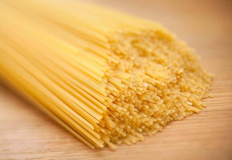 Wheat raw spaghetti closeup stock photos