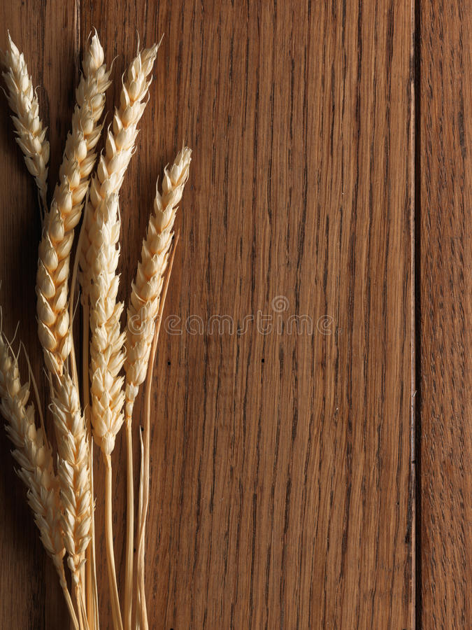 Download Wheat Spikes On Wooden Board Stock Photo - Image: 13085362