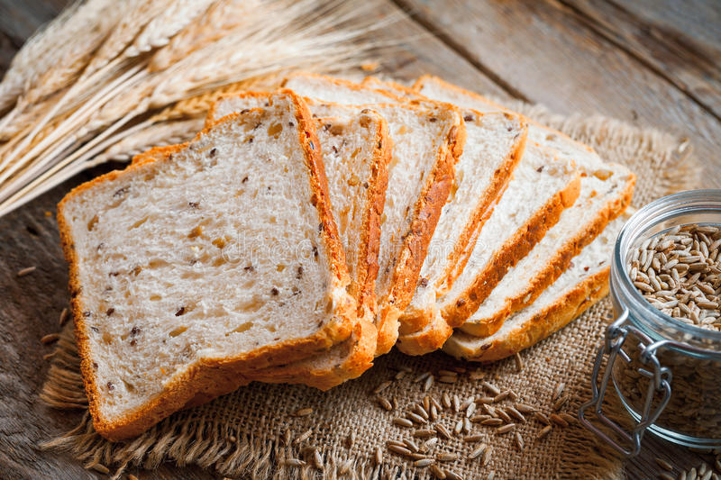 Wheat toast bread, spikes and wheat grains stock images
