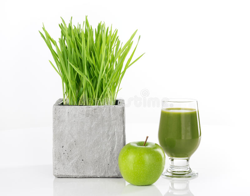 Wheatgrass, apple and green juice royalty free stock image