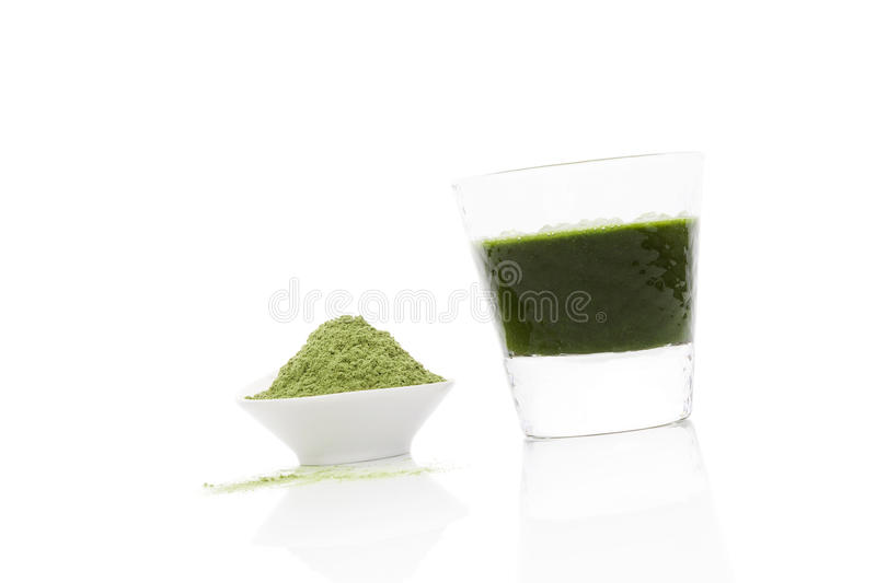 Wheatgrass. Wheatgrass juice and powder on white background. Health care concept. Organic natural dietary supplement royalty free stock images