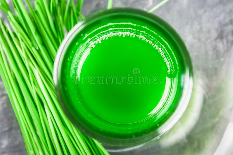 Wheatgrass shot. Juice from wheat grass. Trend of health. royalty free stock photography