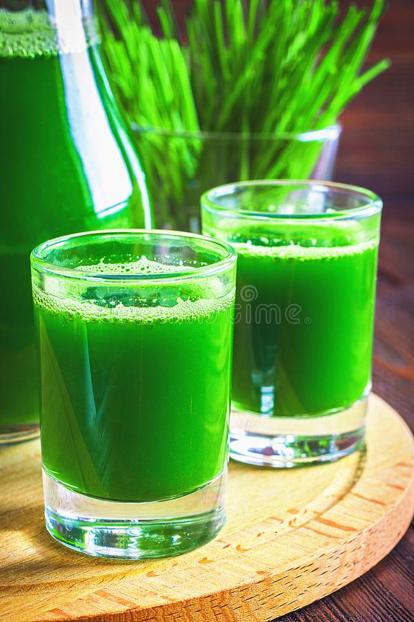 Wheatgrass shot. Juice from wheat grass. Trend of health. royalty free stock photos