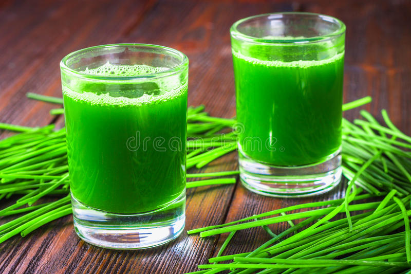 Wheatgrass shot. Juice from wheat grass. Trend of health. Wheatgrass shot. Juice from wheat grass. Trend of health royalty free stock image
