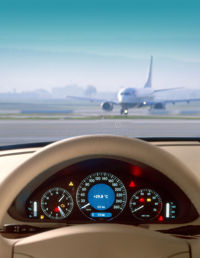 Wheel. And dashboard of a car and view of airport royalty free stock photo