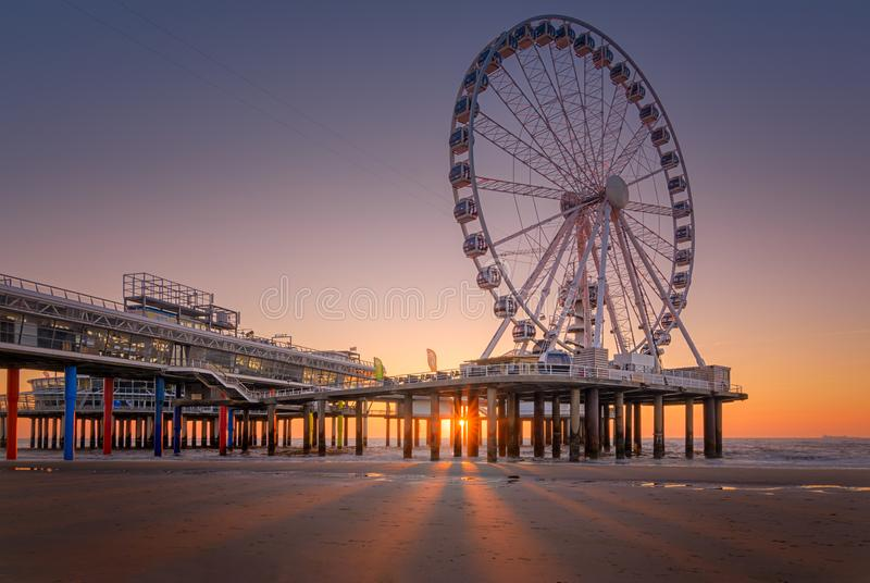 The Wheel. Another edit from this weeks trip to Scheveningen. The Ferris Wheel on the Pier during sunset. round an road we go!!!! I was attracted bij the play royalty free stock photography