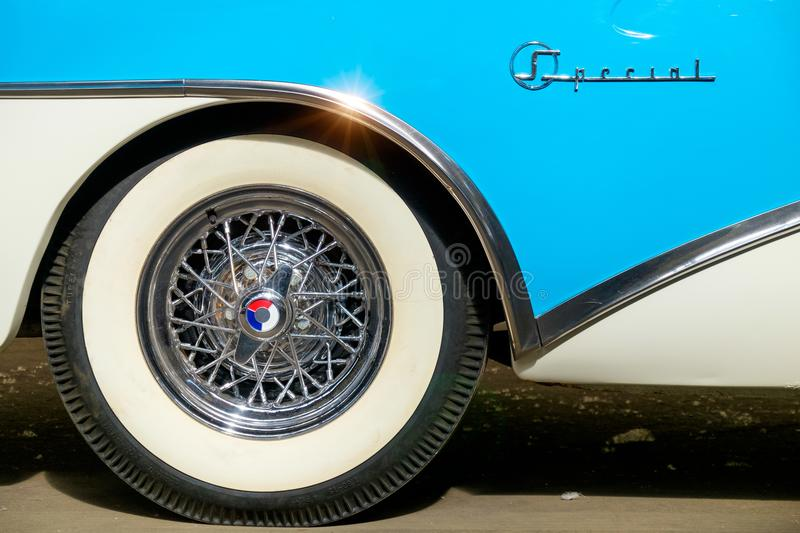 The wheel of an antique car with a white rim. royalty free stock photo