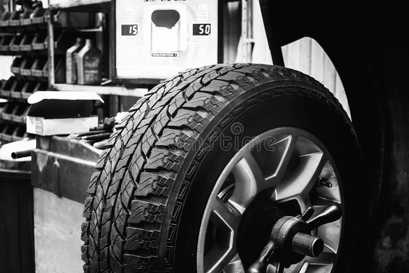 Wheel in balancing tire changer royalty free stock photos