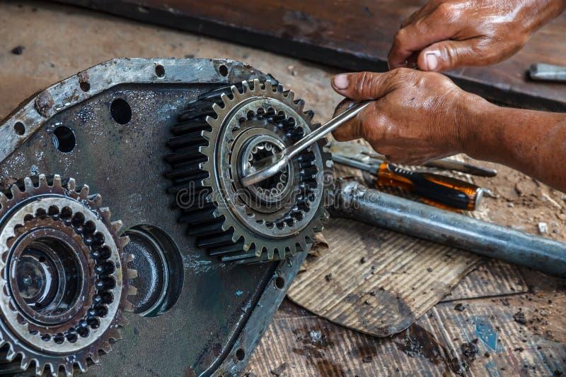 Wheel bearings. Mechanics remove the wheel bearings royalty free stock image