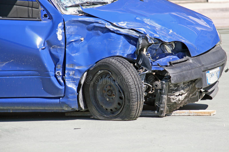 Wheel of a car destroyed in a traffic accident. Wheel of a blue car destroyed in a traffic accident royalty free stock photos