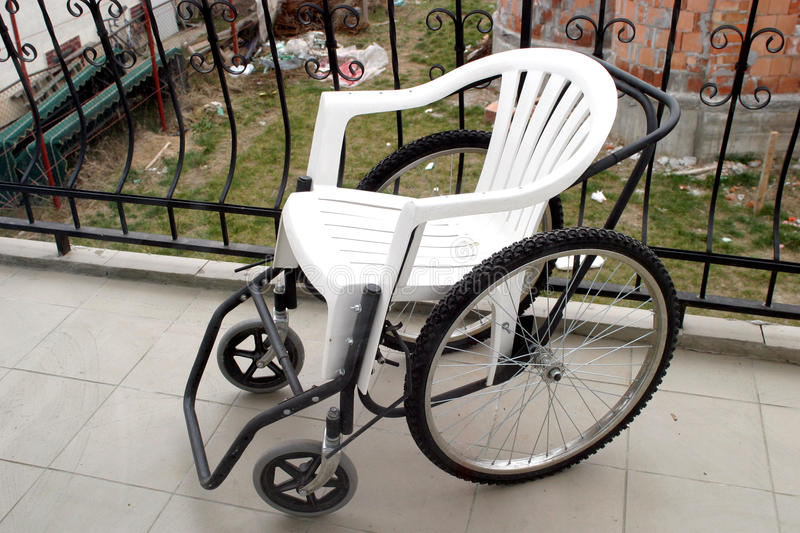 Wheel chair. A improvised wheel chair, detail stock image