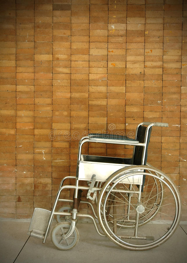 Wheel chair. A wheel chair in a hospital stock photography
