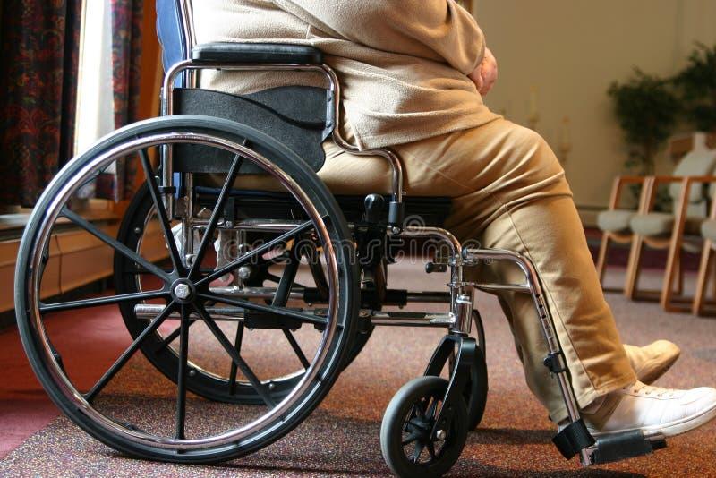Wheel chair. Profile royalty free stock photos