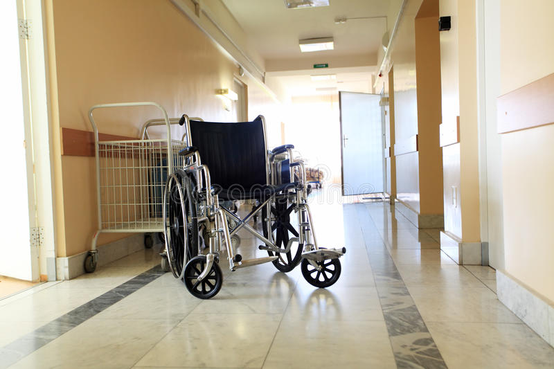 Wheel chair. Medical theme: a wheel chair in a hospital royalty free stock image