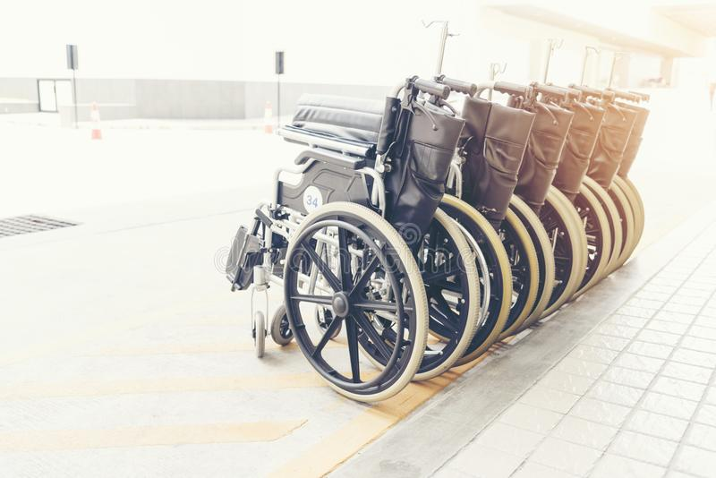 Wheel chair with the hard sunlight. For handicap person stock images