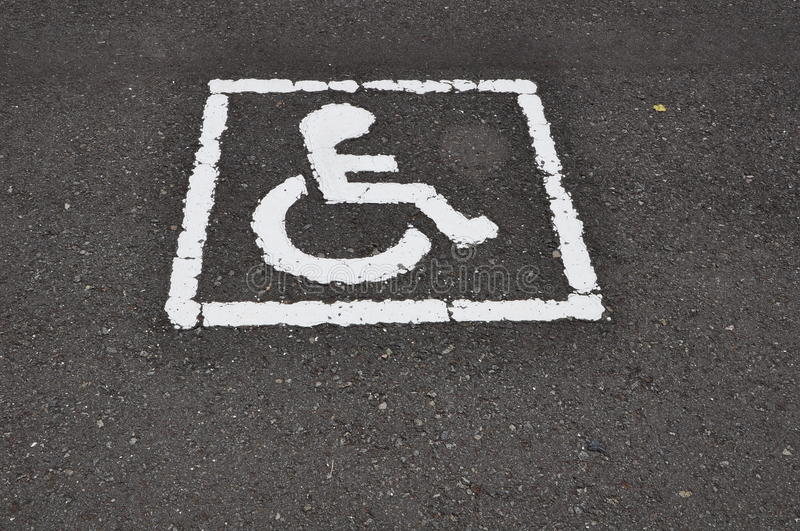 Wheel chair logo. From the road surface royalty free stock photo