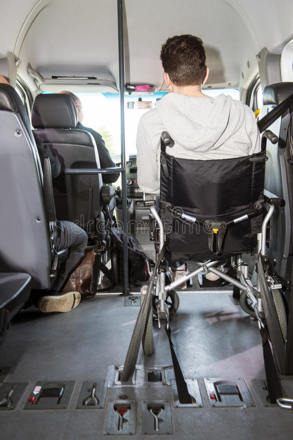 Wheel chair in minivan. Man in a wheel chair sitting in a modified minivan, used for transporting disabled people stock photos